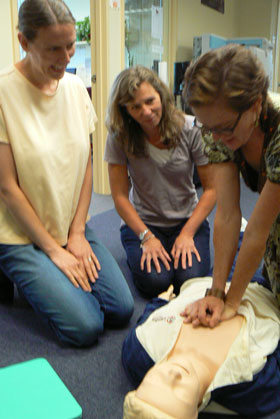 Hendrika Meischke with colleagues practicing CPR