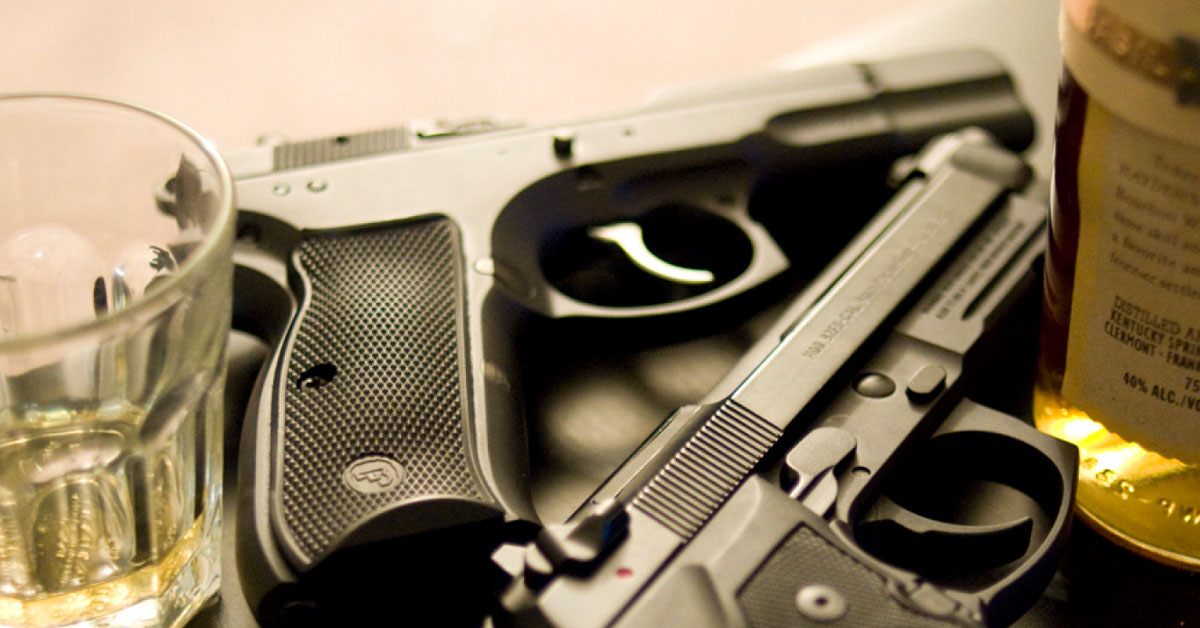 gun and alcohol photo