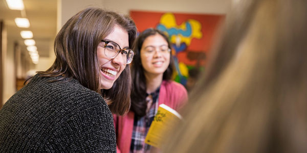 Student smiling in conversation