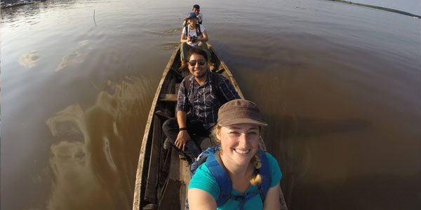 Jorge Alarcon, Leann Andrew and others on a boat on the Amazon River