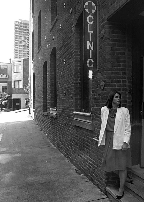 Christine Hurley poses outside the Pike Market Medical Clinic