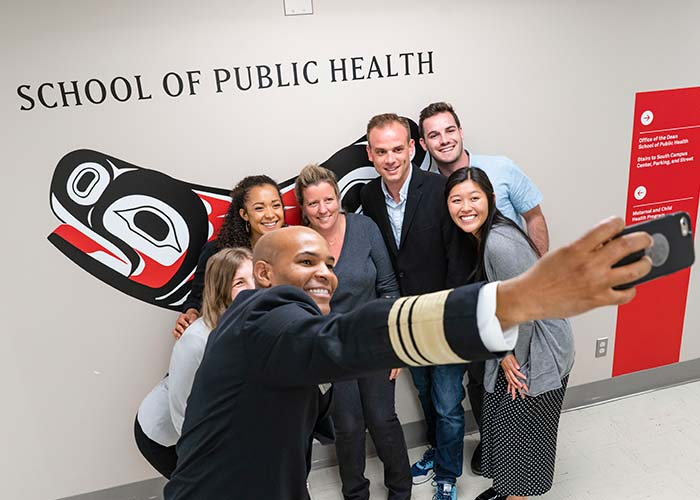 Jerome Adams selfie with students in front of SPH Soul Catcher
