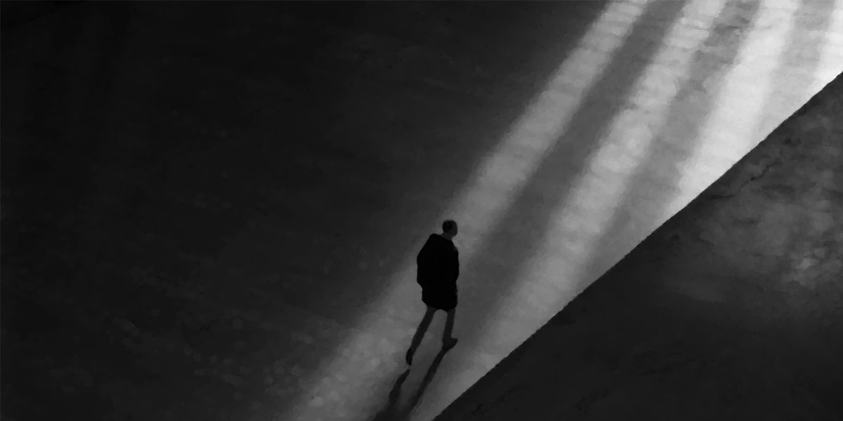 Black and white illustration - human figure walking into the light