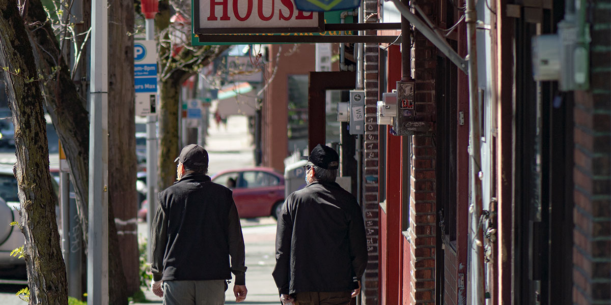 Older adults walking through the International District